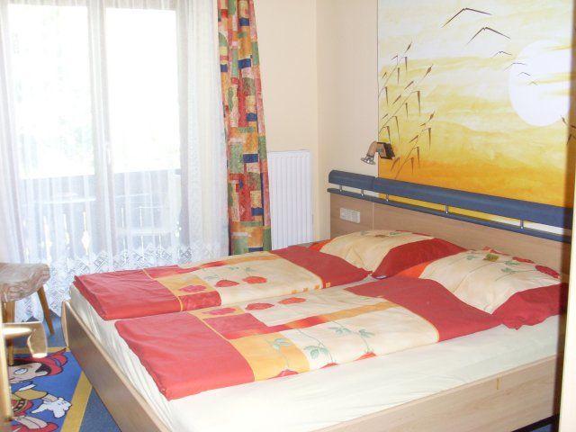 Schlafzimmer der Ferienwohnung A - Pension Muehlenheim Faaker See